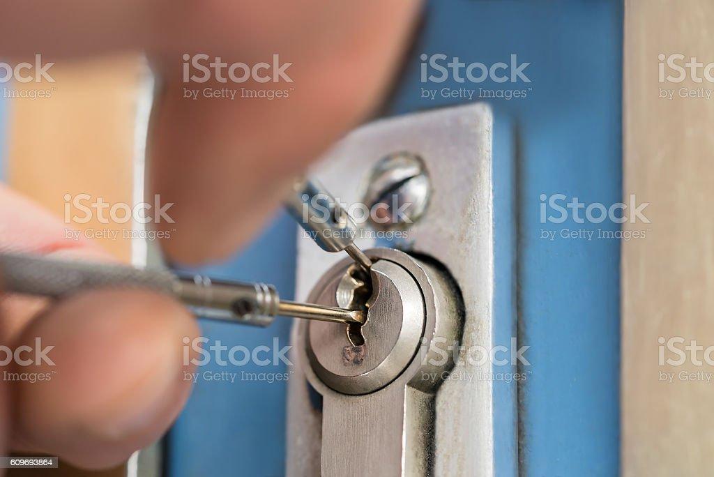 Lockpicker Fixing Door Handle At Home stock photo