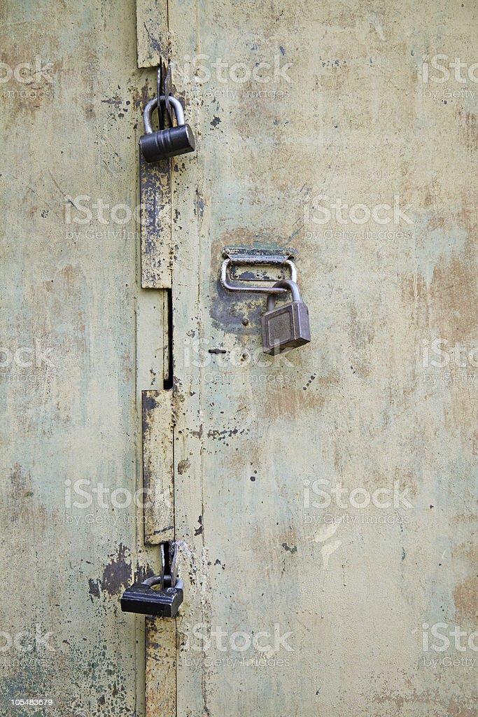 locks on metallic door royalty-free stock photo