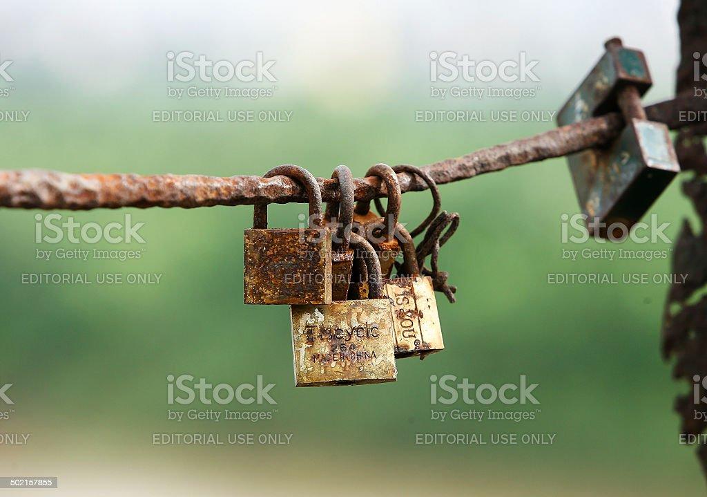 Locks on the bridge stock photo