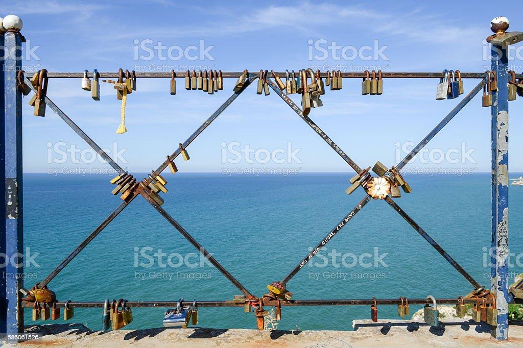 Locks on the fence of the bridge stock photo