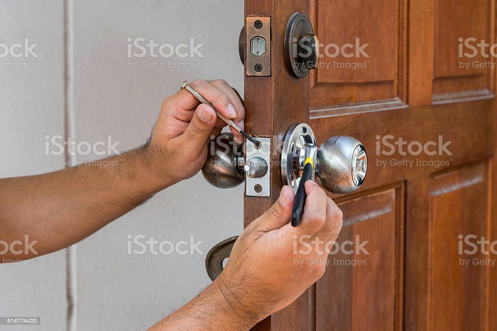 locksmith have to fix silver knob stock photo