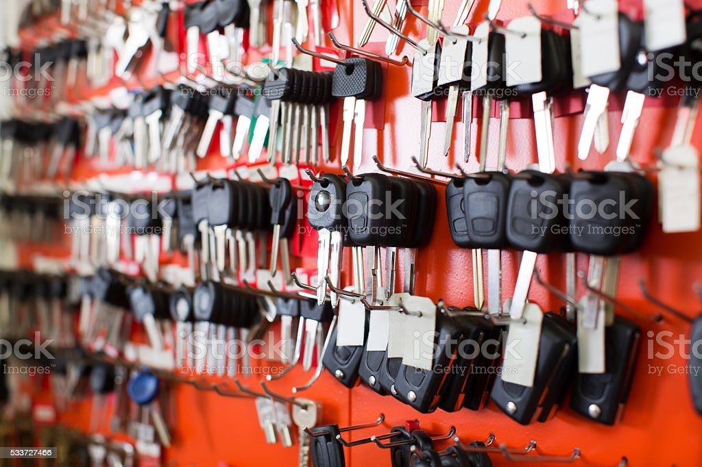 Locksmith stand with car keys on hooks stock photo