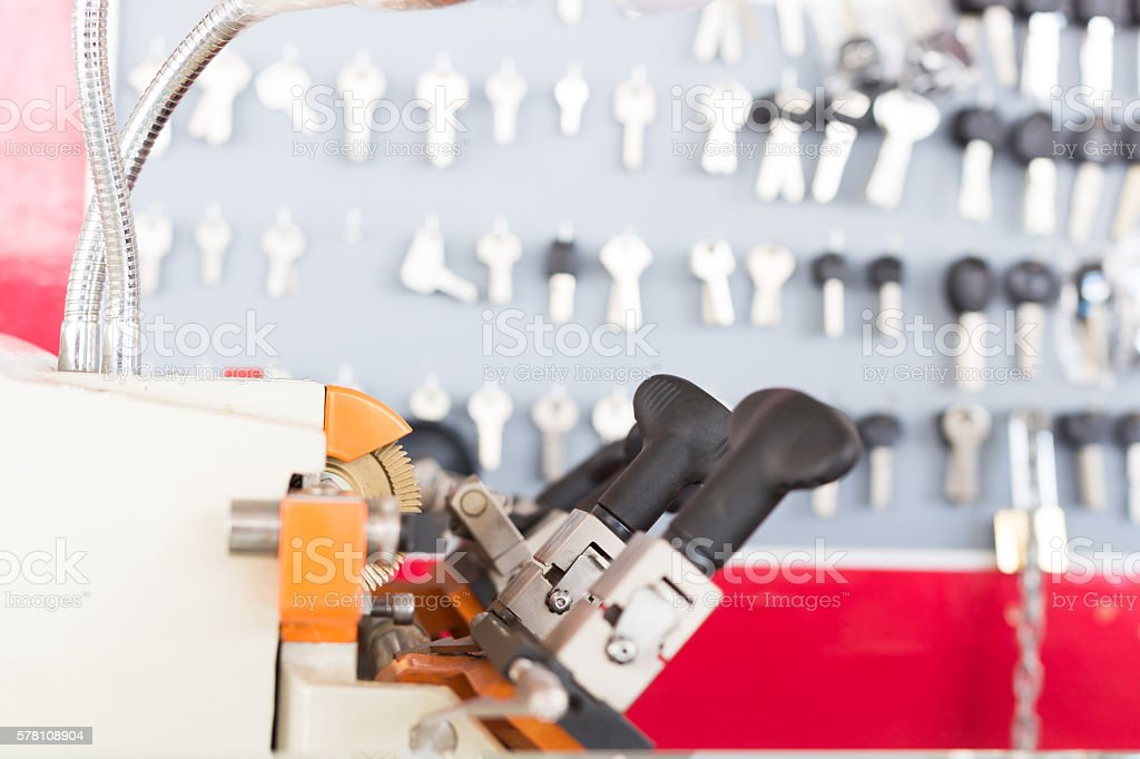 Locksmith tools on blur keys stand background stock photo