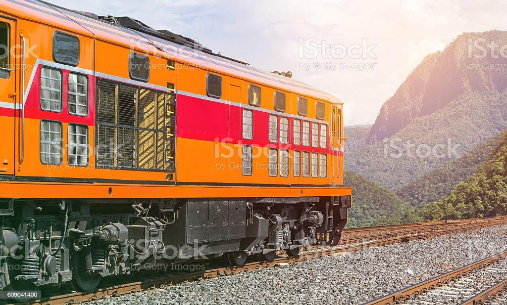 locomotive train crossing valley mountains stock photo