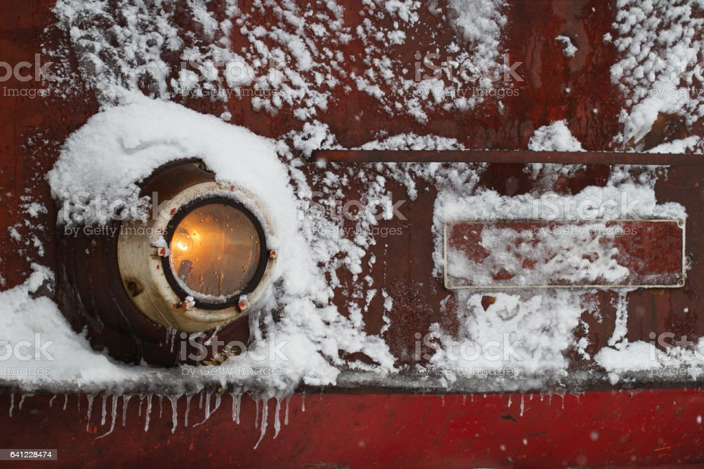 locomotive train detail with headlights covered in snow stock photo