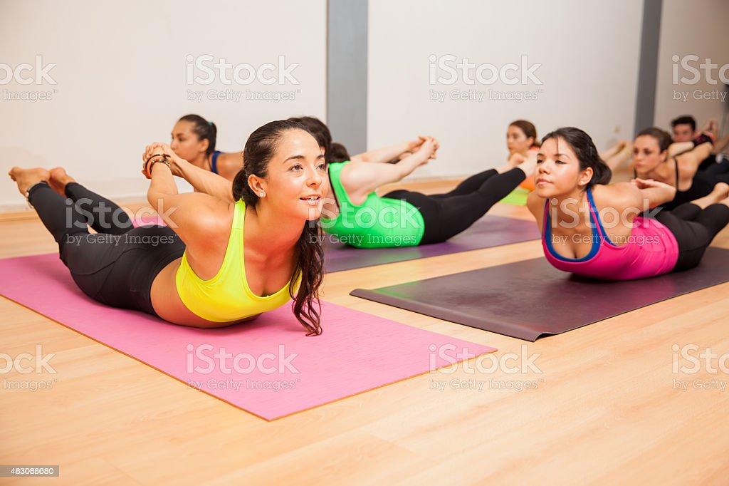Locust pose in a yoga studio stock photo