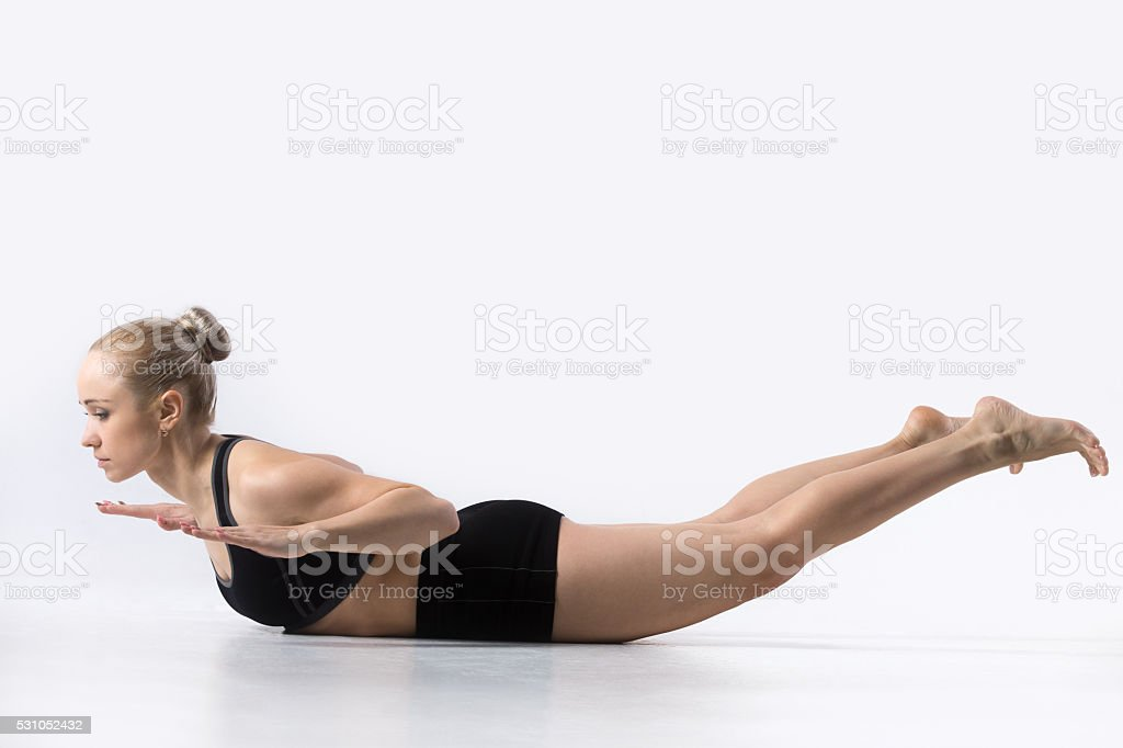 Locust Pose, Salabhasana stock photo
