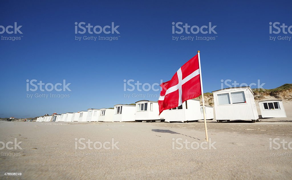 Loekken beach and Danish flag stock photo