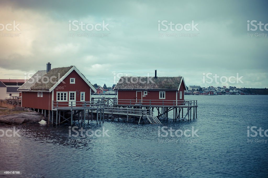 lofoten norway, seaview, red houses on stilts - blue stock photo