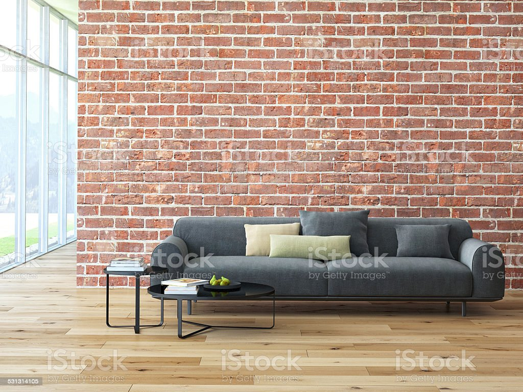 Loft interior with brick wall and coffee table stock photo