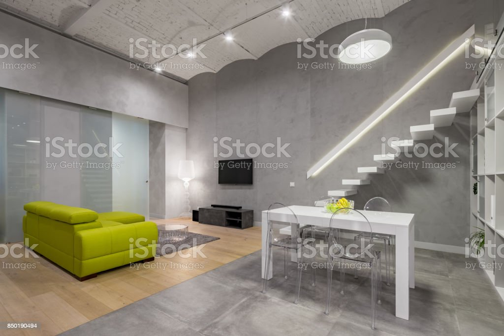 Loft living room with stairs stock photo