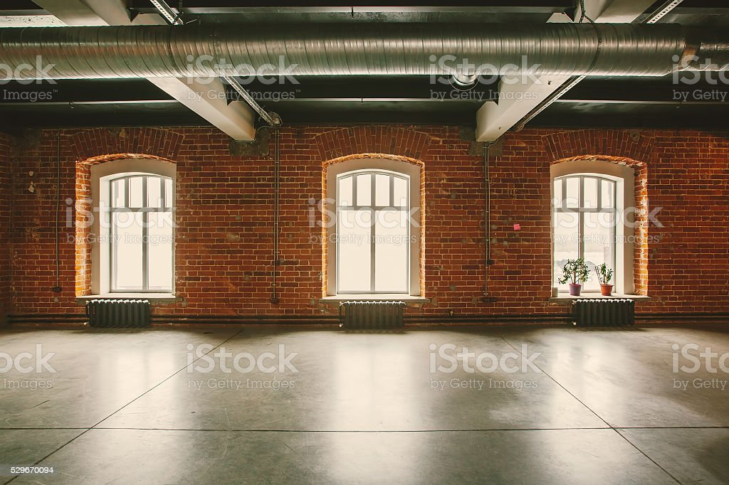 Loft studio Interior in old house. Big windows stock photo