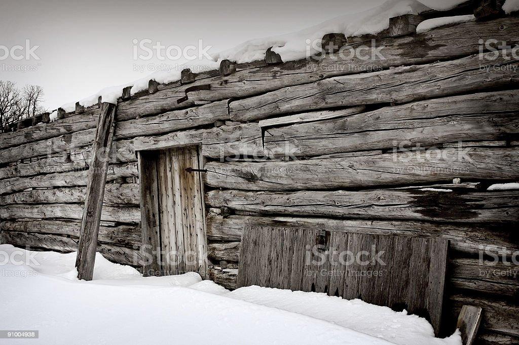 Log Barn in Snow stock photo