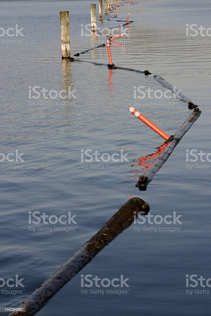 log barrier in water stock photo