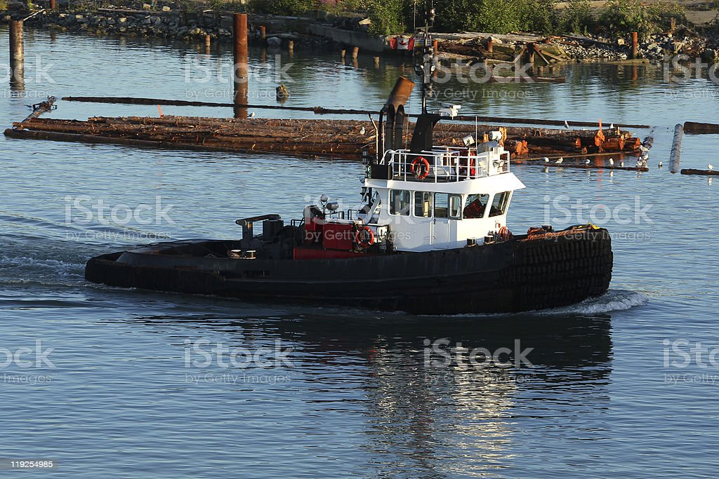 Log Boom Tug Boat stock photo