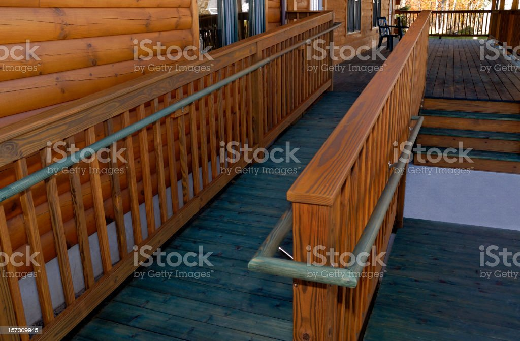 Log Building Wheelchair Handicapped Wooden Access Ramp stock photo