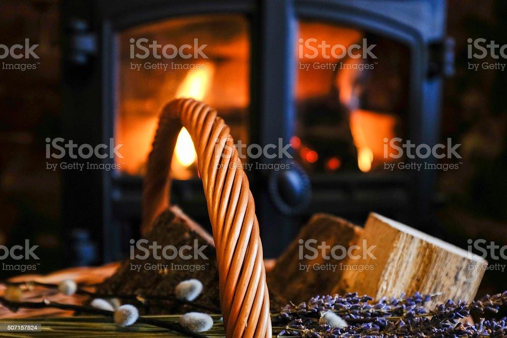 Log Burning Fire with Log Basket stock photo