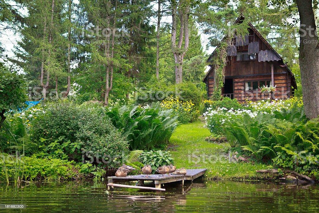 Log Cabin at the river Krutynia, Mazury royalty-free stock photo