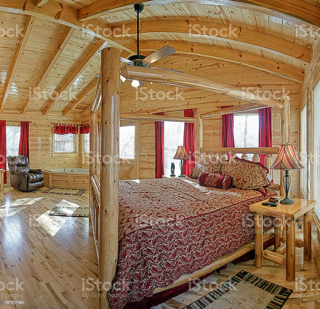 Log cabin bedroom with jacuzzi royalty-free stock photo