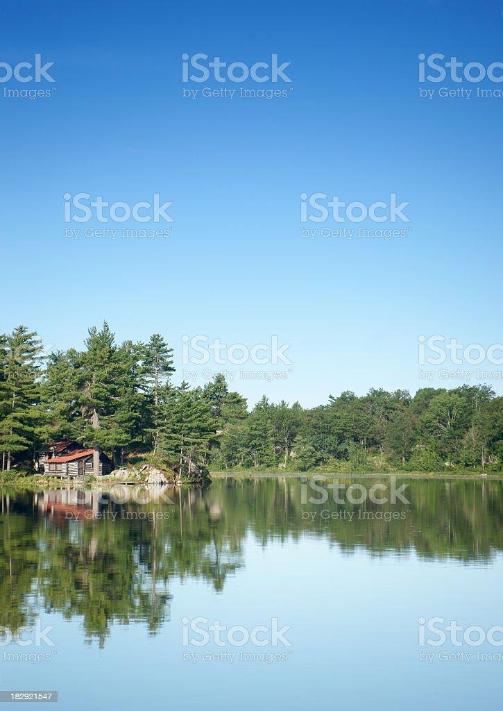 Log cabin by an Ontario lake, morning stock photo