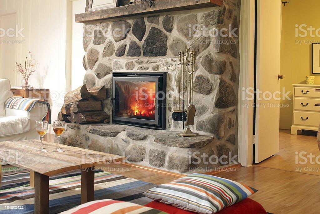 log cabin fireplace stock photo