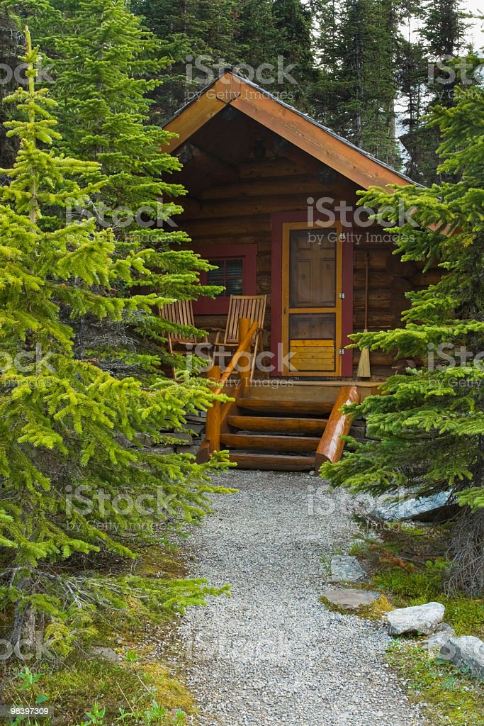 Log Cabin Hidden In The Forest royalty-free stock photo