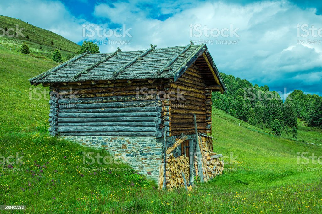 Log cabin in the moutain stock photo