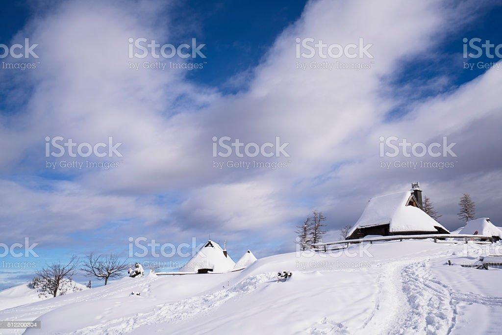 Log Cabins of Plateau Velika Planina, Slovenia stock photo