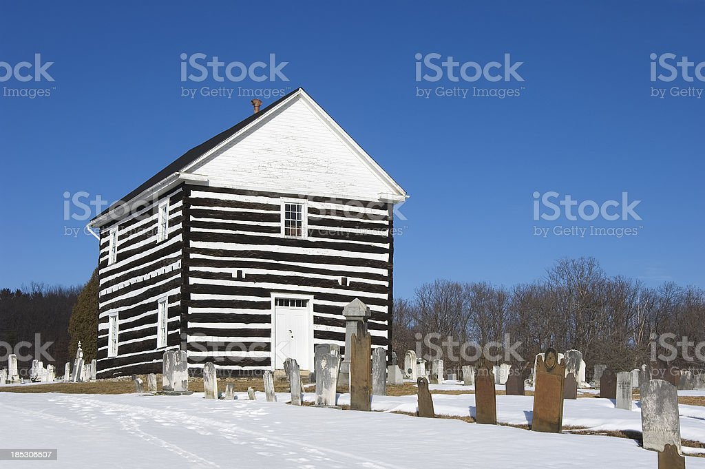 Log Church in Snow and Sunlight, Built 1806 Historic Pennsylvania stock photo