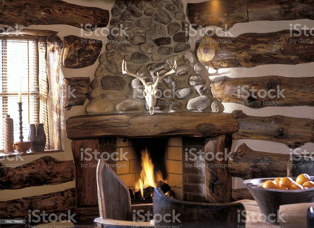 log fire in cabin stock photo