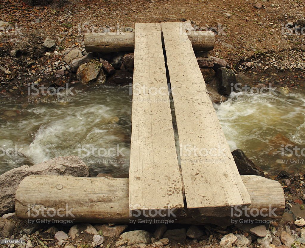 Log Plank Bridge Over Mountain Creek royalty-free stock photo