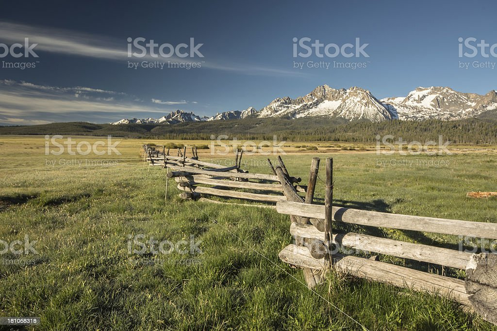 Log Rail Fence points Toward Sawtooth Mountains of Idaho royalty-free stock photo
