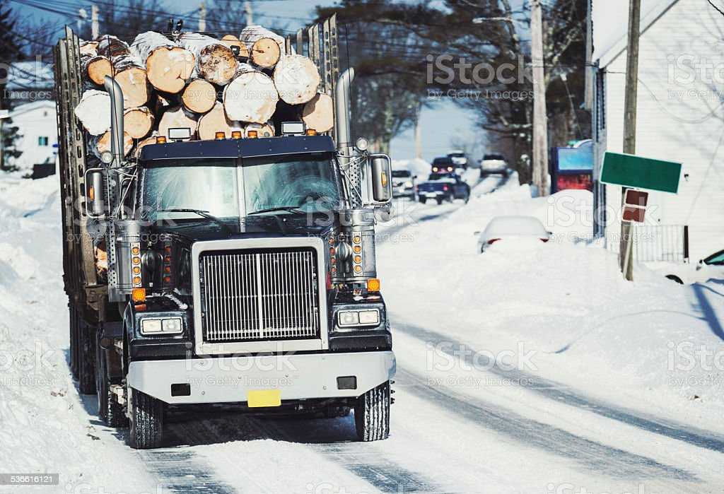 Log Truck in Small Town stock photo