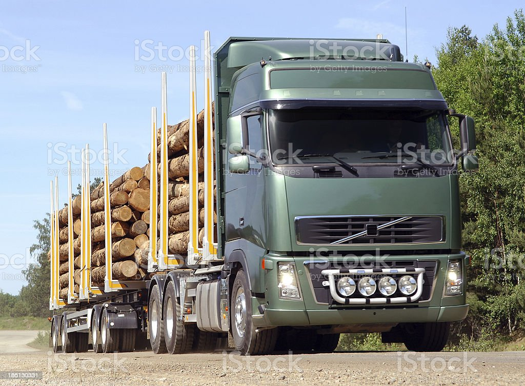 Log truck on country road stock photo