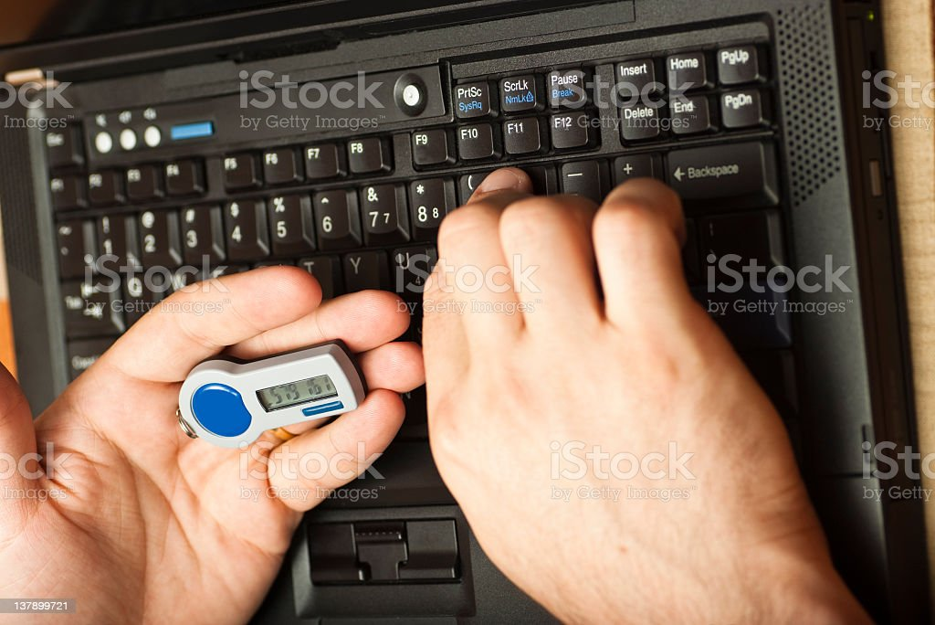 Logging on to Online Banking using two factor authentication token stock photo