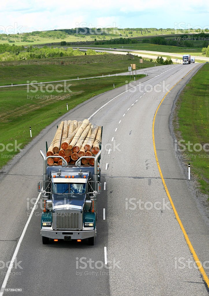 Logging Truck on a Beautiful Rolling Highway stock photo