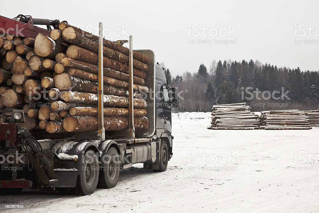 logging truck on a loading place during winter. royalty-free stock photo