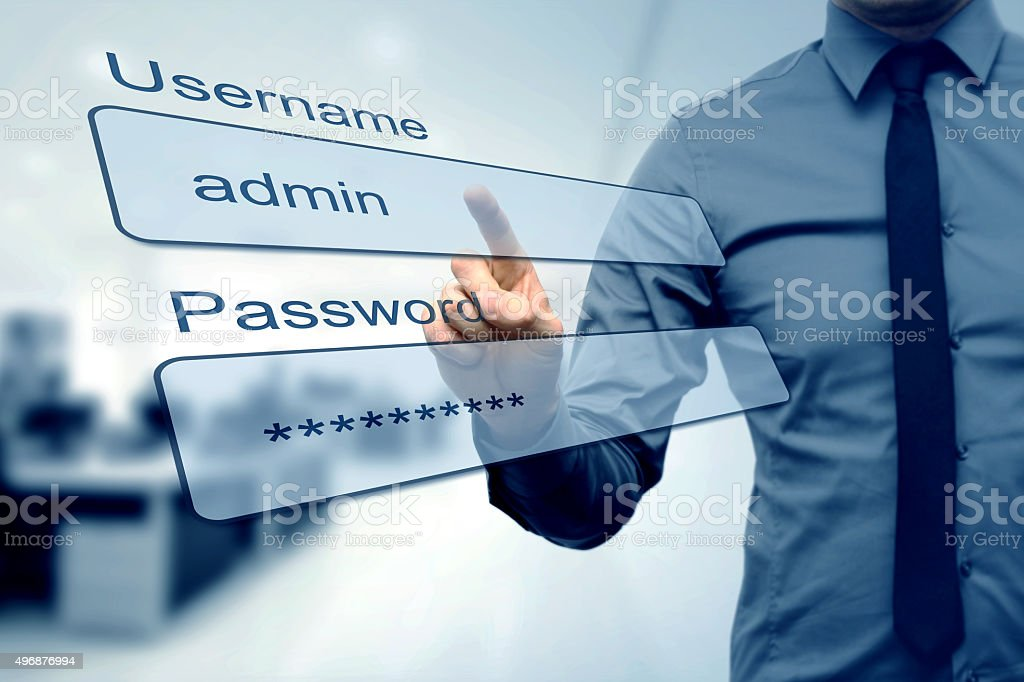 login box - finger pushing username and password fields stock photo