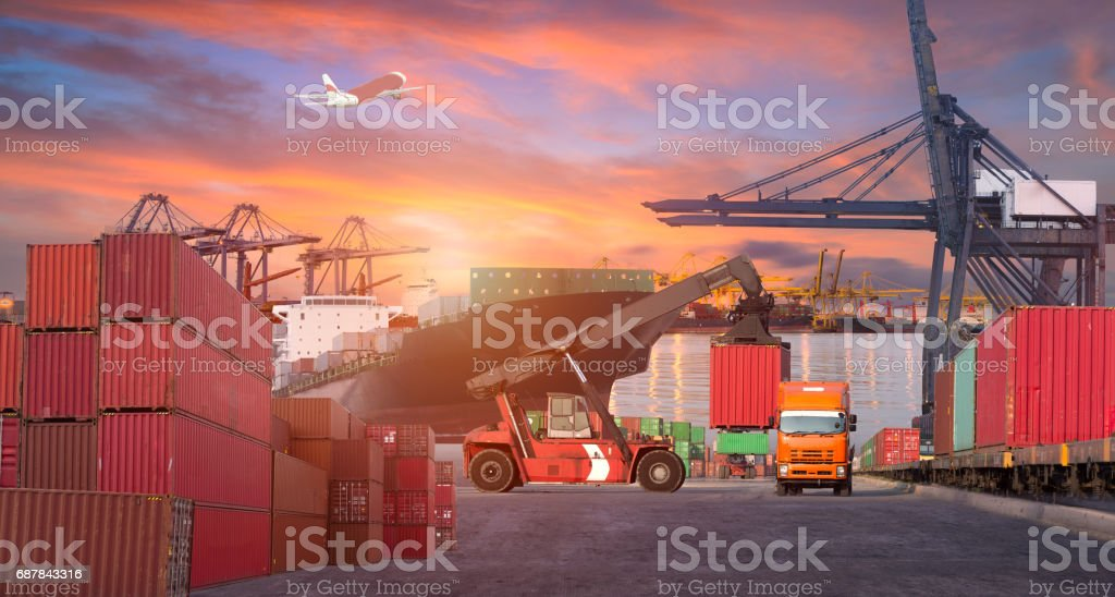 Logistics and transportation of Container Cargo ship and Cargo plane with working crane bridge in shipyard at sunrise, logistic import export and transport industry background stock photo