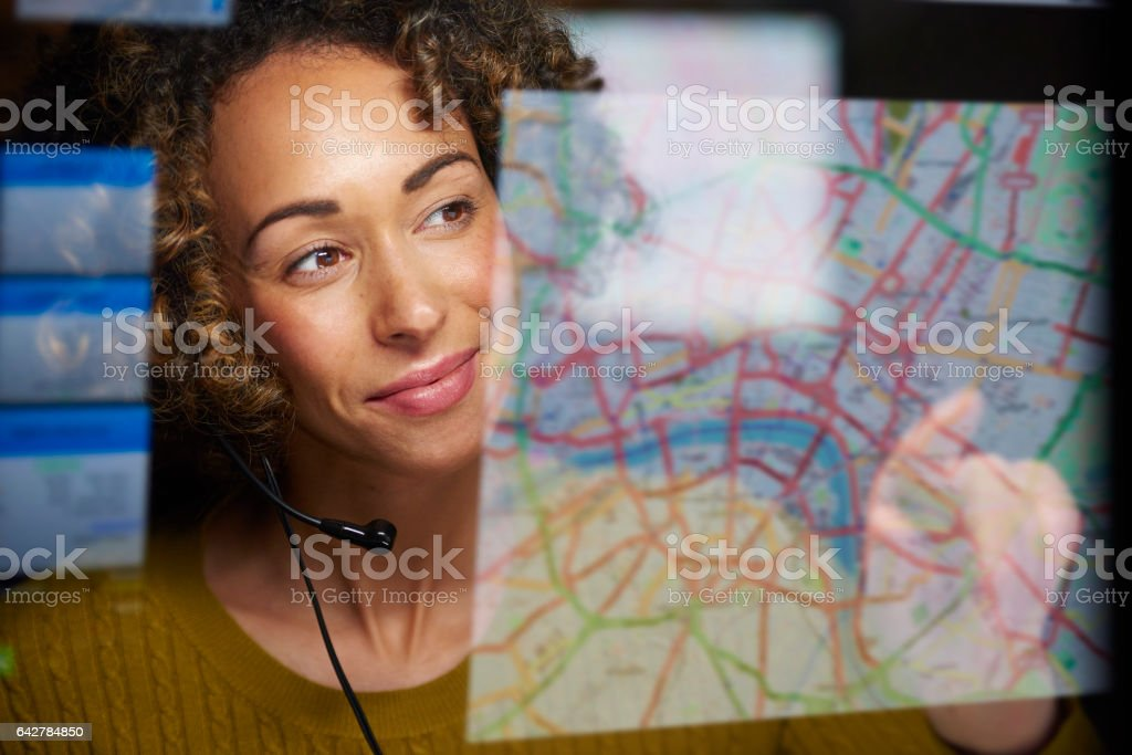 logistics dispatcher with digital display stock photo