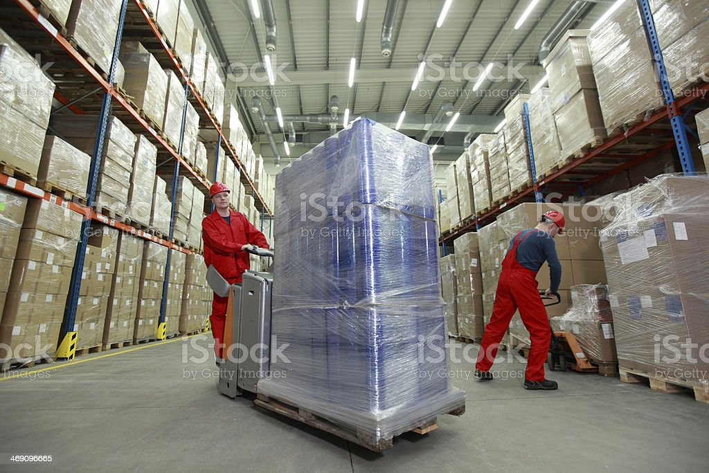 Logistics,two workers working in storehouse stock photo