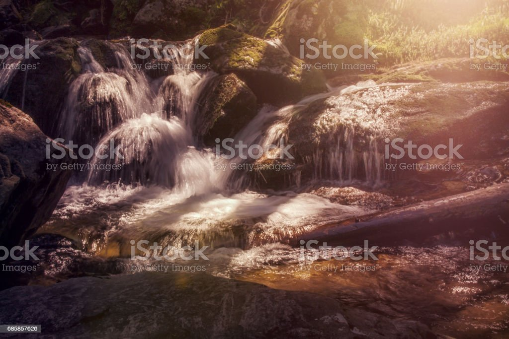 Logn exposure at a little waterfall with sun stock photo