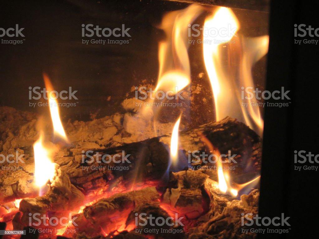 Logs burning bright stock photo