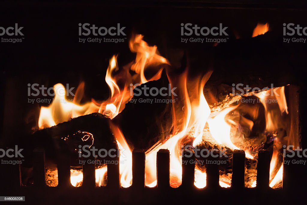Logs in a Fire, Fireplace, Miners Cabin, Wales stock photo