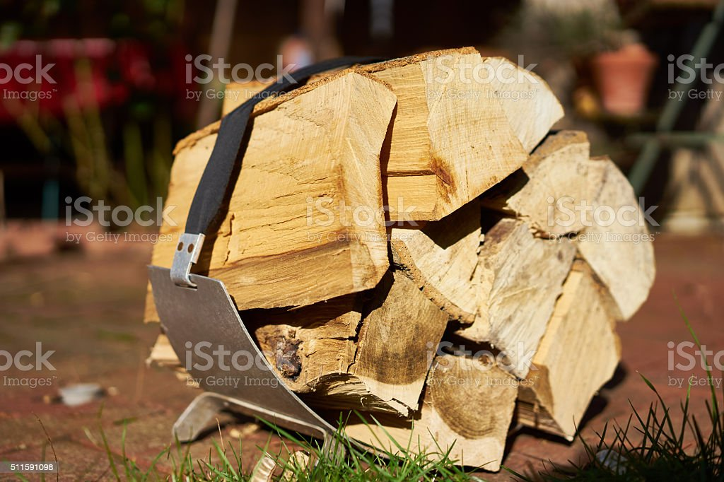 Logs of slitted wood on stretcher stock photo