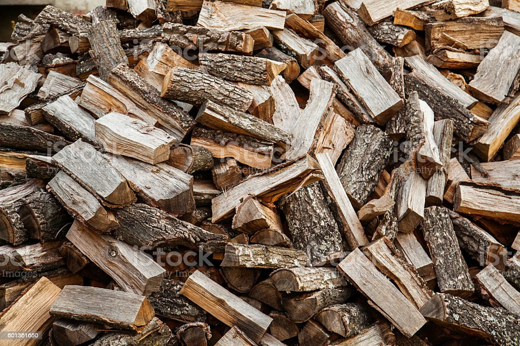 logs of wood on mounds prepared for heating stock photo