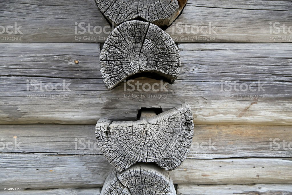logs stacked on one another,house wall stock photo