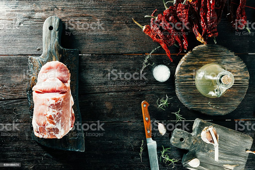 Loin and spices on wooden board stock photo