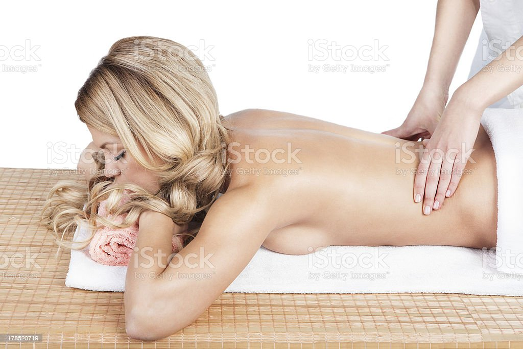 Loin massaging therapy of back in the spa salon. royalty-free stock photo
