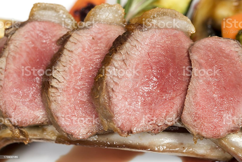Loin of lamb cooked pink royalty-free stock photo